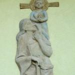 Hausfassadenschmuck in Frensdorf mit Hlg. Christopherus. Christus hält einen Bienenkorb in Händen